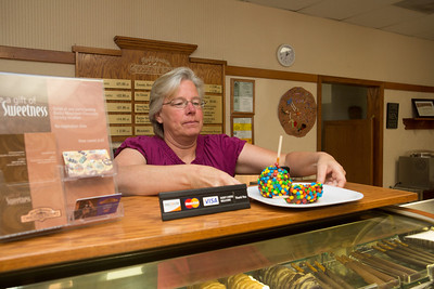Debbie Button really likes working at the Rocky Mountain Chocolate factory which she and her husband John purchased after moving to Paso Robles.