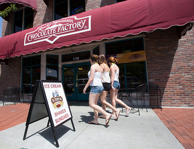 Heads turn for chocolate as a group of young ladies pass by John and Debbie Button's Rocky Mountain Chocolate factory which they purchased after moving to Paso Robles.