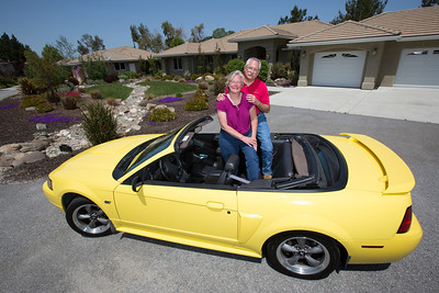 Their relationship started as high school sweathearts and now John and Debbie Button stand in Debbie's yellow Mustang convertible in front of their Paso Robles home. The Buttons sold their million dollar home in Danville to buy one half the price on a bigger lot in Paso Robles, where they now own a chocolate shop. Their grandkids live three blocks away and are a big part of their lives. John who worked in high tech, is semi-retired, and likes to ride his motorcycles on the backroads of Paso Robles and up and down the coast. Debbie really likes working at the chocolate shop which they purchased after moving to Paso Robles.