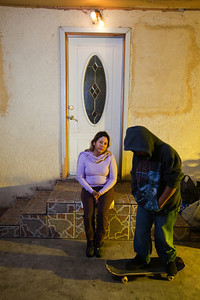 Teresa Arredondo,lf, sits with her son, Roberto,11, who rides a skateboard at their Bakersfield home on Mon. November 7th, 2011.