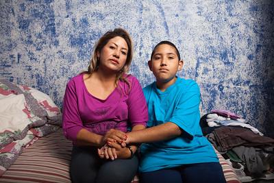 Teresa Arredondo,lf, and her son, Roberto, sit in Roberto's bedroom in their Bakersfield home on Sat. November 5th, 2011.