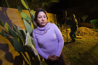 Teresa Arredondo,lf, stands with her son, Roberto,11, in their backyard at their Bakersfield home on Mon. November 7th, 2011.