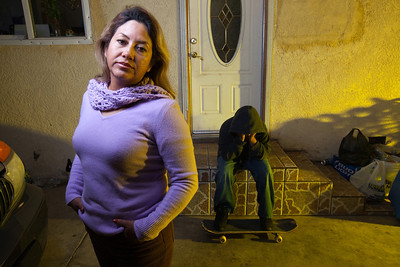 Teresa Arredondo,lf, stands with her son, Roberto,11, at their Bakersfield home on Mon. November 7th, 2011.