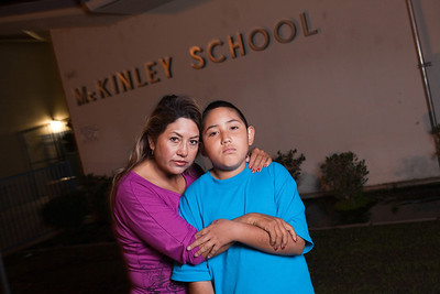Teresa Arredondo,lf, and her son, Roberto, stand in front of McKinley Elementary School in Bakersfield on Sat. November 5th, 2011.