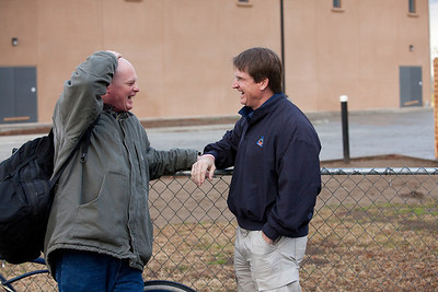 VISALIA,CA--Danny Little, Executive Director of the Visalia Rescue Mission, laughs with VRM resident Charles Taylor in front of the new VRM offices nearing completion.