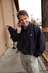 VISALIA,CA--Danny Little, Executive Director of the Visalia Rescue Mission, speaks on his cell phone in front of the new VRM offices. The Visalia Rescue Mission is a Christian-based non-profit organization that serves the local community by providing a homeless shelter for men, women and children. The VRM sleeps on average 130 people each night and serve three meals a day; 365 days a year.