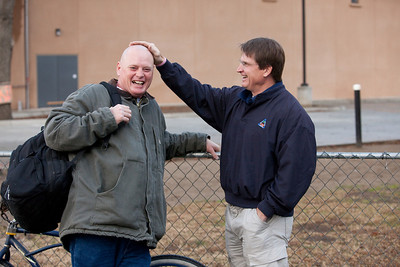 VISALIA,CA--Danny Little, Executive Director of the Visalia Rescue Mission, laughs with VRM resident Charles Taylor as he pats his head in front of the new VRM offices nearing completion.