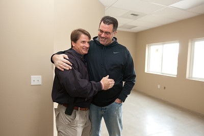 VISALIA,CA--Danny Little, Executive Director of the Visalia Rescue Mission, lf,laughs Alex Reeder, Men's program Director, in the newly constructed offices at the VRM.