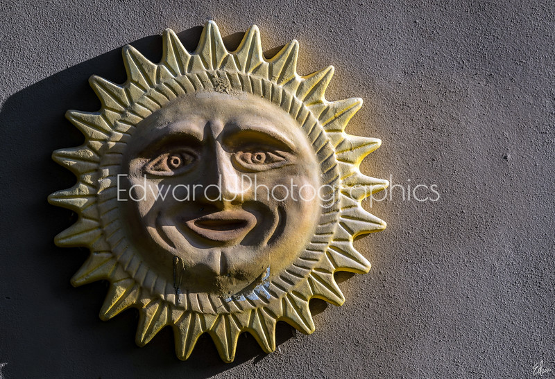 Sun Statue On A Wall...