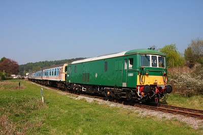 73001 leads CIG set 1499 in a 5 coach mode+31466 on the 1430 Parkend to Lydney junction at Whitecroft 20th April 2011