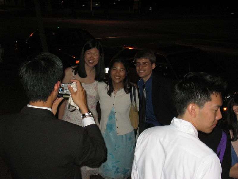 Reception End - Ben Liu taking a photo of Lillian Yow, Lisa Wong, & Cory Benavides