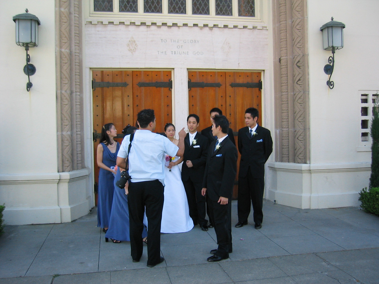 Photo shoot outside Grace Lutheran Church - photographer directs wedding party