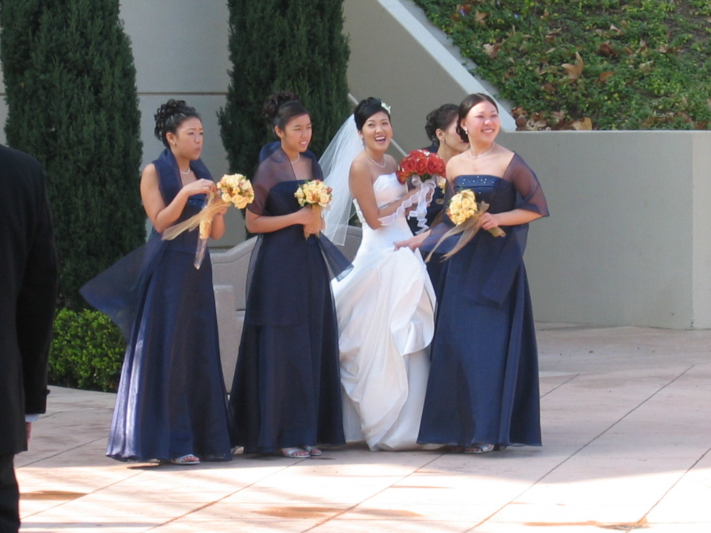 Bride and maids outside