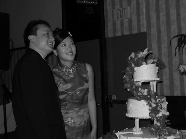 B&W of Mike, Natalie, & the cake