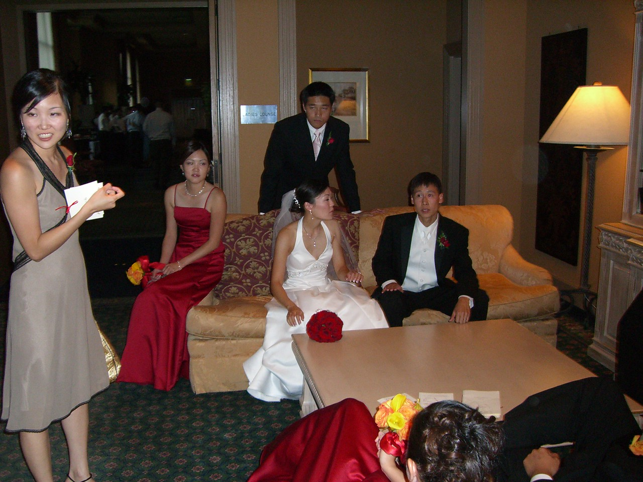 Wedding party waiting to enter reception