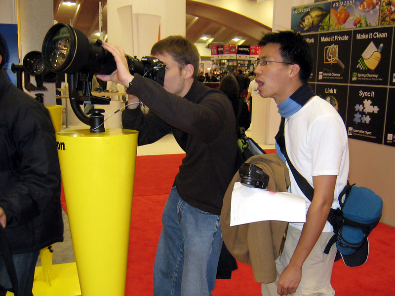 Check out the size of that lens!  <br /> <br /> Cory and Ben