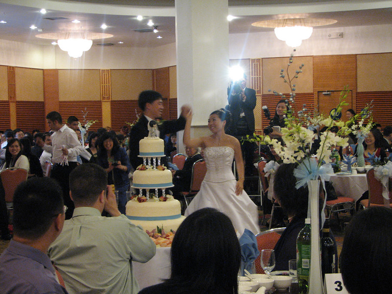 2007 05 19 Sat - Reception - Bride & Groom 1st dance behind cake 4 - spin