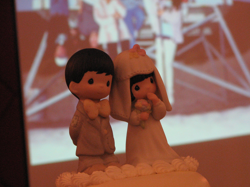 2007 05 19 Sat - Reception - Precious Moments cake topper against slideshow