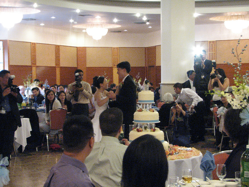 2007 05 19 Sat - Reception - Bride & Groom 1st dance behind cake 3 - laughing