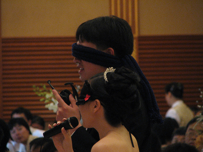2007 05 19 Sat - Reception - Bride & Groom sing Karaoke Revolution while blindfolded
