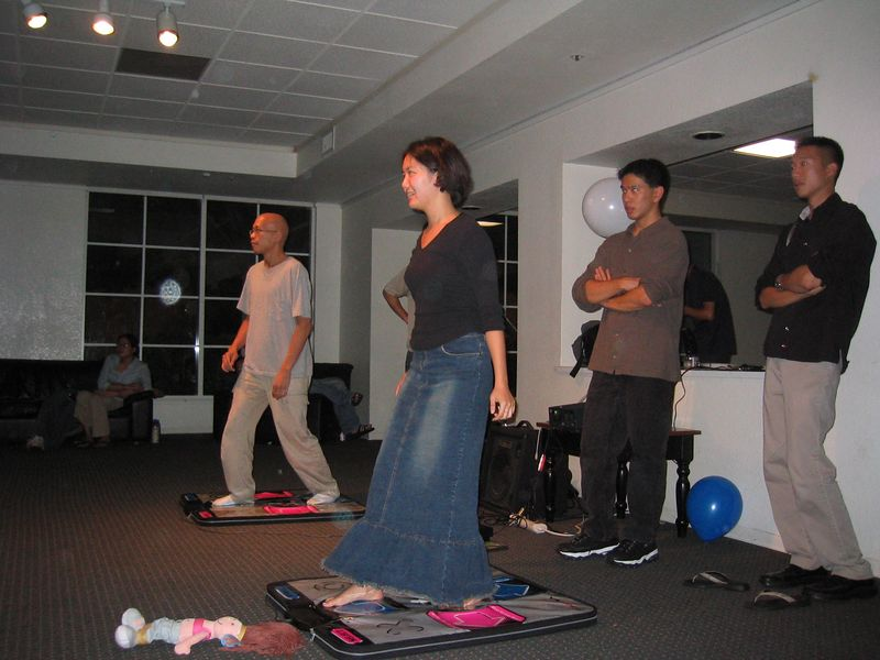 Gilbert Gong & Cheryl Shih DDR under Joe-Sensei's watchful eye, & Andy Wu's 'child' is left unattended on the floor