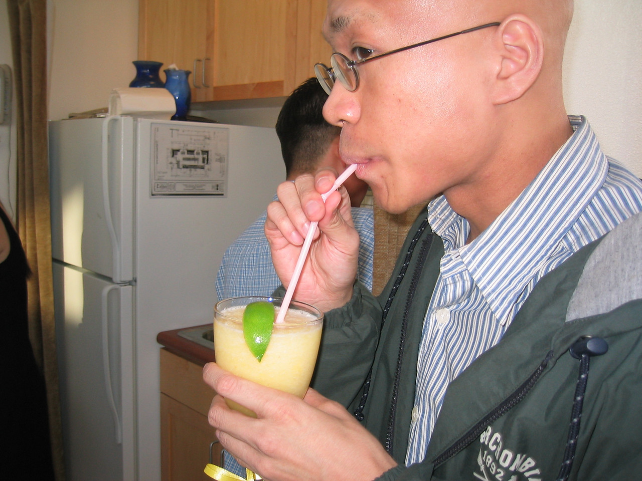 Gilbert daintily sips Eileen & Sam's non-alcoholic brew