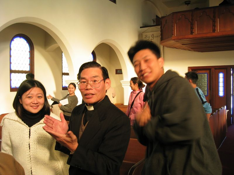 Luke sneaks a pic with Pastor Chen