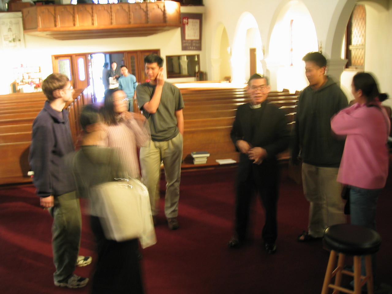People standing around with Pastor Chen
