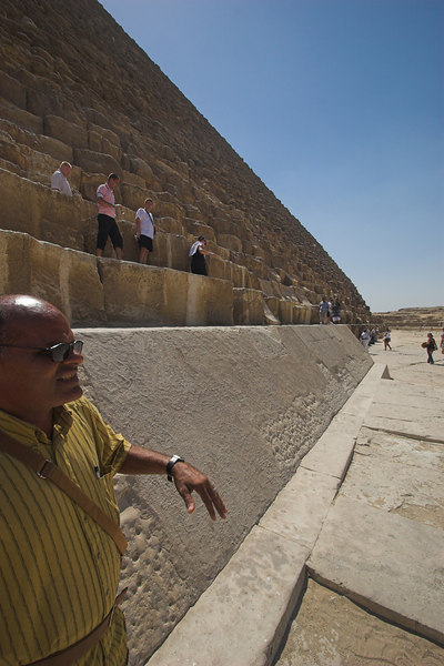 The Great Pyramid of Khufu (Cheops) and our Guide<br /> Notice the Original Smooth Limestone Outer Blocks on the Lower Level