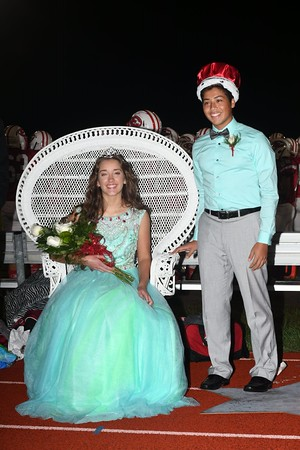Seniors Alex Denoyer and Antonio Munoz smile for pictures after being crowned the 2016 Effingham High School queen and king Friday evening at Klosterman Field.<br /> Chet Piotrowski Jr. photo/Piotrowski Studios