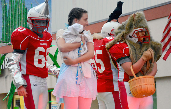 """There's No Place Like Homecoming<br /> <br /> Lynzee Hagan """"Dorothy"""", center, and """"Tin Man"""" Danny Hortenstine, brave the cold, windy conditions Wednesday during Effingham High School's Homecoming Parade.<br /> <br /> Cathy Griffith photo"""