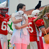 "There's No Place Like Homecoming<br /> <br /> Lynzee Hagan ""Dorothy"", center, and ""Tin Man"" Danny Hortenstine, brave the cold, windy conditions Wednesday during Effingham High School's Homecoming Parade.<br /> <br /> Cathy Griffith photo"