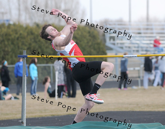 Chase McCurdy high jumps at the Osage Track Meet on Monday, April 7, 2014 in Osage, Iowa. Ej Photo/ Colby Fossey