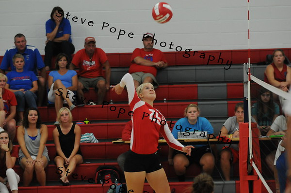 Noelle Hulshizer goes for one of her 17 kills vs Decorah in St Ansgar. (EJ Photo/ Colby Fossey)
