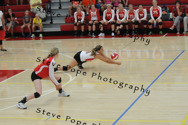 Tara Kramer digs one of her 5 digs for the night against Decorah on Tuesday, September 2, 2014 in St Ansgar, Iowa. (EJ Photo/ Colby Fossey)