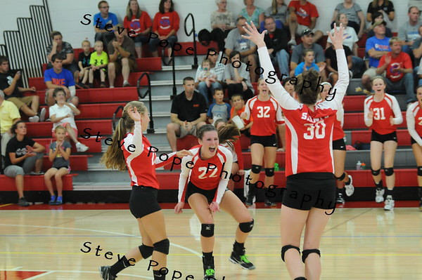 MiKayla McCurdy and her Saints teammates celebrate after scoring a tough point against Decorah. (EJ Photo/ Colby Fossey)