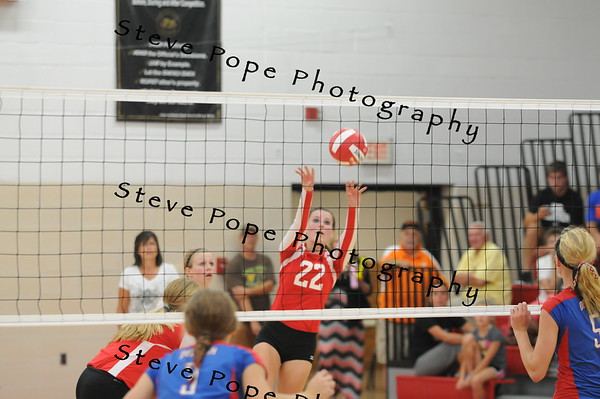 MiKayla McCurdy pushes the ball back to Decorah on Tuesday, September 2, 2014 in St Ansgar, Iowa. (EJ Photo/ Colby Fossey)