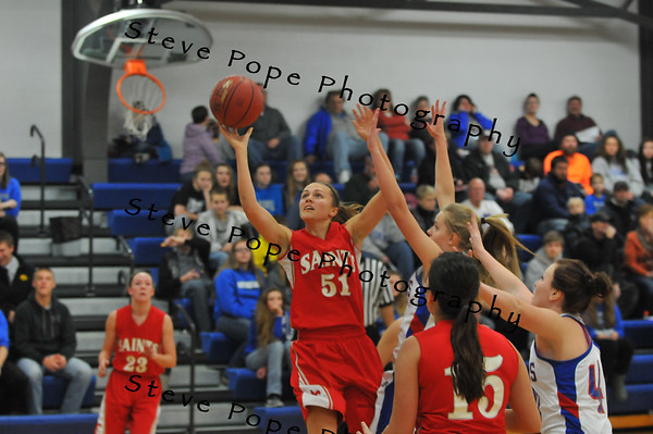 Kelsie Willert drives to the paint and throws up her shot against the Vikings on Tuesday, December 9, 2014 in Northwood, Iowa. (EJ Photo/ Colby Fossey)