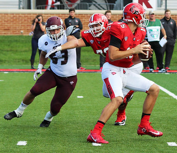 Eastern Kentucky University linebacker Jeffery Canady closes in on Ball State quarterback Riley Neal on Saturday, September 17, 2016. Eastern Kentucky lost 41-14 to Ball State.