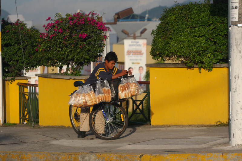 Panaderia en Wheels... The bread boy sells bread daily on his bicycle.