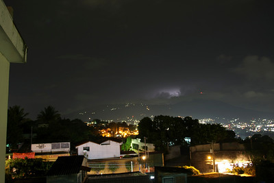 A Night view of San Salvador, with a touch of lightning just over the volcano.