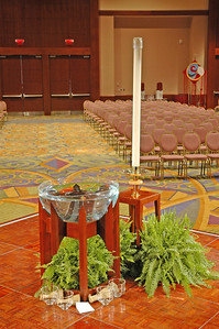 Baptismal font and Christ candle in the worship space