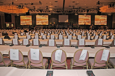 Plenary Hall-chairs and tables lined up and labeled by synod