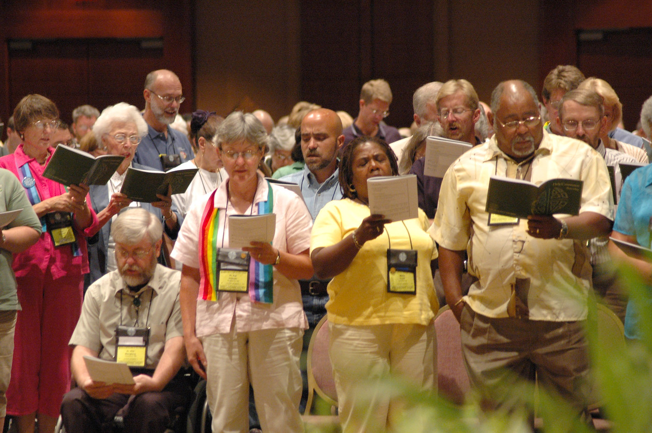 Voting Members follow along during Saturday's Worship service.