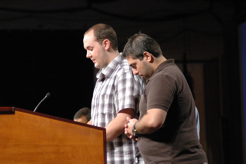 Members of the Young Adult Convocation pray with the Assembly.