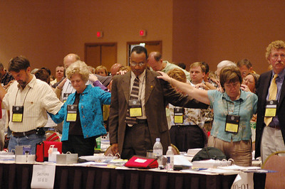 Voting members praying for Christian unity