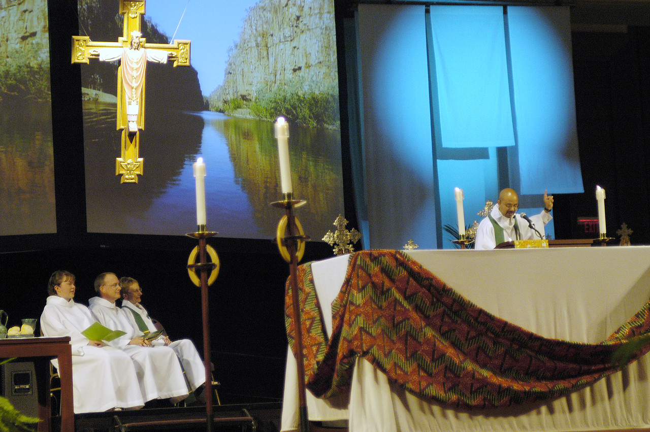 Projected images provide a backdrop for the worship service.
