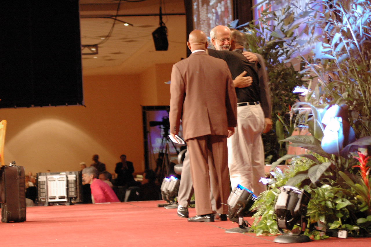 Bishop Hanson hugs Bassam Abdallah on the adoption of the Arab and Middle Eastern Ministry Strategy