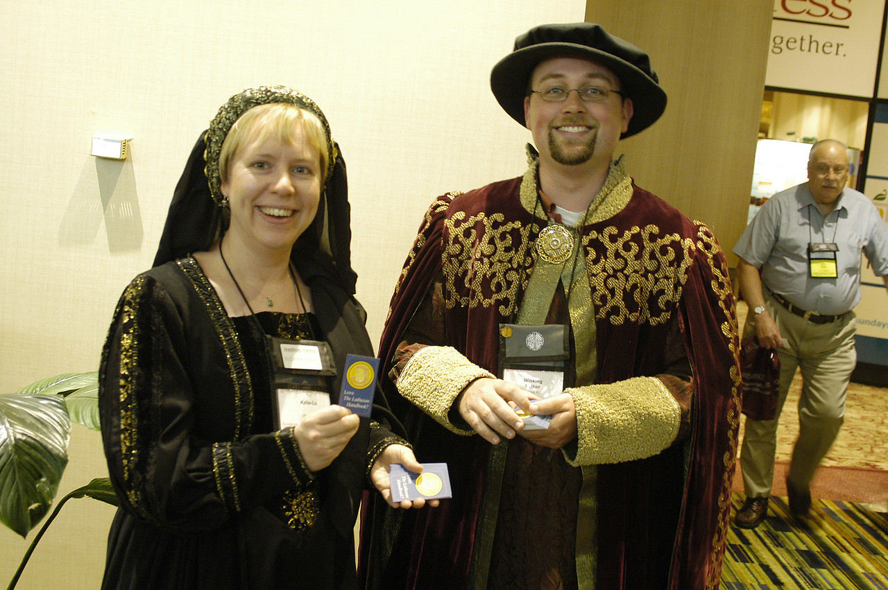 Katie Lu and Winking Luther greet visitors to the Augsburg Fortress store.