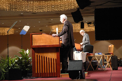 Pr. Lowell Almen, ELCA Secretary, and Presiding Bp. Mark Hanson address the Assembly from their respective podiums.